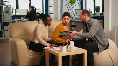 Multiethnic Team Analysing Informations From Tablet