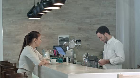 Thumbnail for Pretty Female Customer Giving Her Phone Number To Handsome Barista