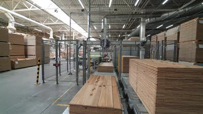 Industrial equipment for the production of parquet. Automation. Industrial interior.