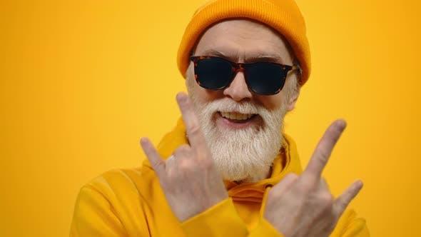 Stylish Senior Man Enjoying Lifestyle in Studio
