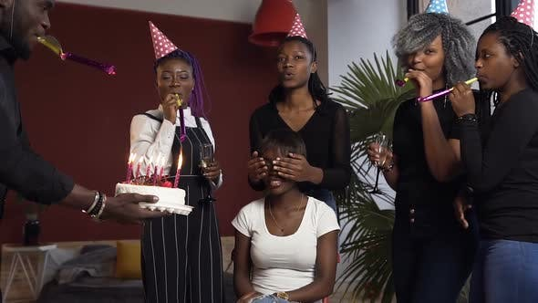 Cover Image for Young African People Making Surprise Party to their Female Birthday Girl