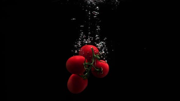 Thumbnail for Red Tomatoes Dropping Into Clean Water In Slow Motion Black Background