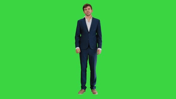Thumbnail for Confident Businessman Showing Thumbs Up and Ok Gestures on a Green Screen, Chroma Key