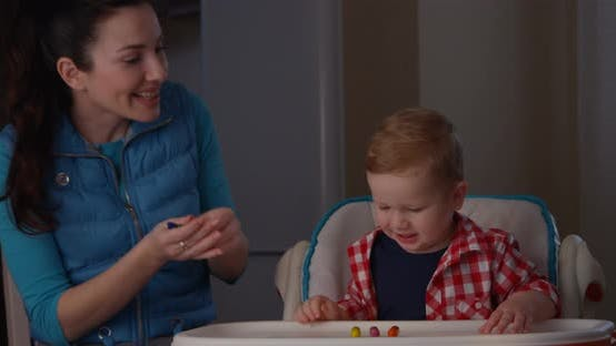 Thumbnail for Portrait of Learning Process Of Mother Trying To Teach Her Child To Count With Fingers Using Games