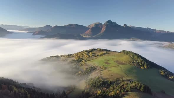 Thumbnail for Aerial Morning above Foggy Landscape Nature in Autumn with Beautiful Golden Colors