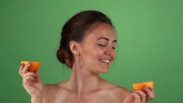 Thumbnail for Gorgeous Happy Female Smiling Holding Oranges on Green Chromakey