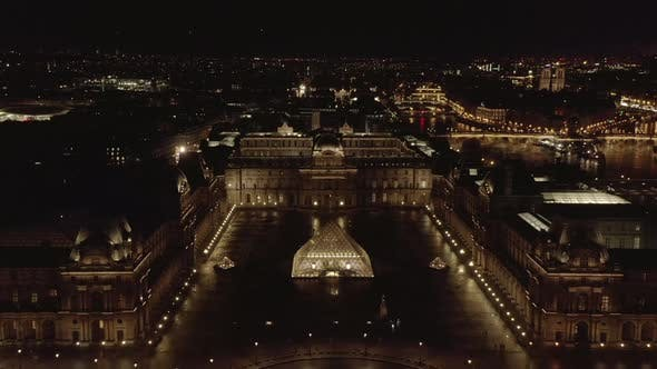 Cover Image for AERIAL: Flight Over Glowing Louvre Museum,Pyramid at Night in Paris, France