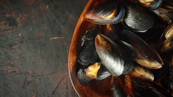 Cooked Mussels in a Wooden Plate.