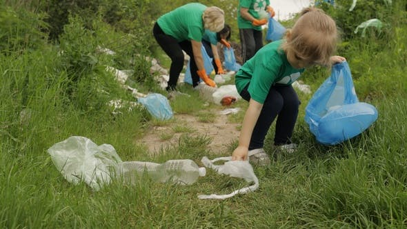 Thumbnail for Volunteer Team Cleaning Up Dirty Park From Plastic Bags, Bottles. Reduce Trash Cellophane Pollution
