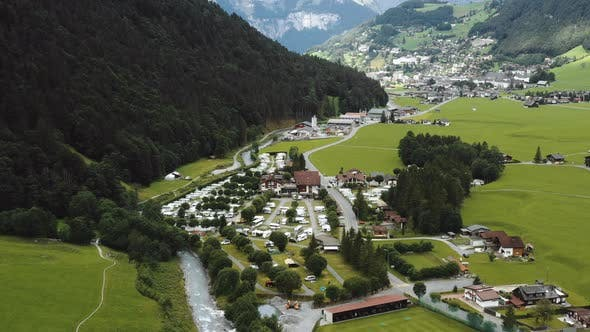 Thumbnail for Amazing Aerial Shot of Beautiful Alpine Camping Site and River on Foot of the Mountain in Engelberg