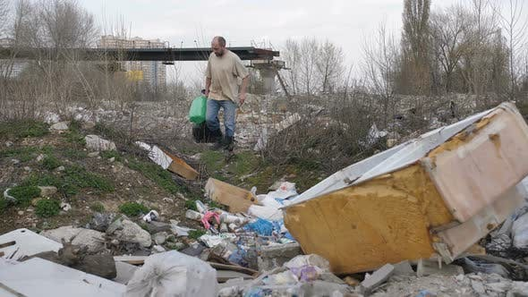 Thumbnail for Mature Male Scavenging for Plastic at Trash Site