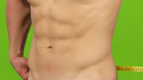 Measure Man Body Volume, Waistline. Closeup on Green Screen Background