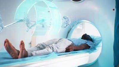 Black Man During Futuristic Full Body CT Scan