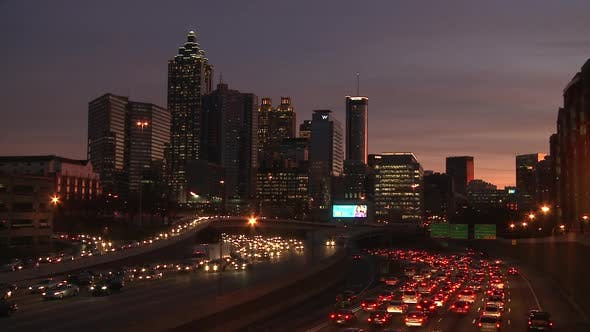 Thumbnail for Static, wide shot of the Atlanta Skyline at night with traffic flowing below.