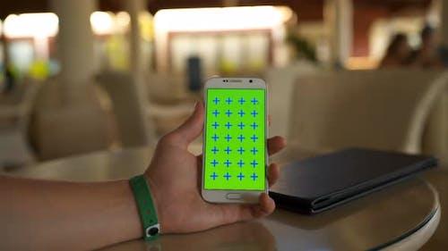 Man Hand Holding Green Screen Mobile Phone Vertical