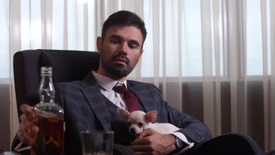 Respectable Man Drinking Whiskey and Petting Dog