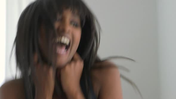 Thumbnail for Excited African American woman listening to music and laughing