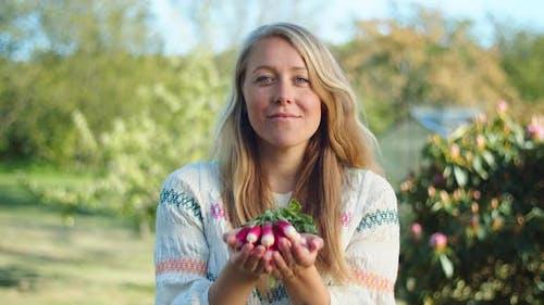 Beautiful Vegan Holding Homegrown Radishes