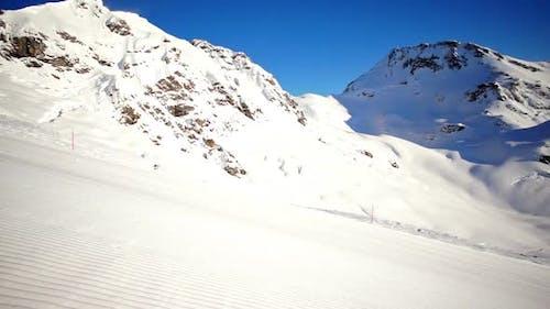 SloMo Skier Carving on Piste