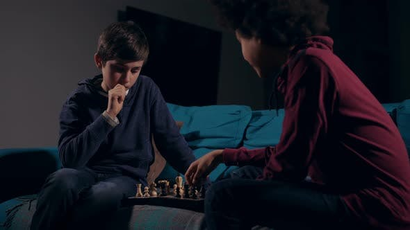 Thumbnail for Diverse Teen Friends Playing Chess Game at Home