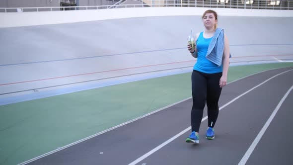Thumbnail for Plus Size Woman Drinking Smoothie After Workout