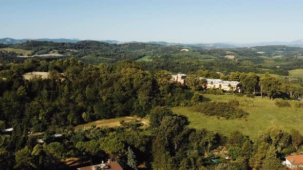 Thumbnail for Drone Flying Above Magnificent Peaceful Houses on Green Tree Hills, Mediterranean Landscape Panorama