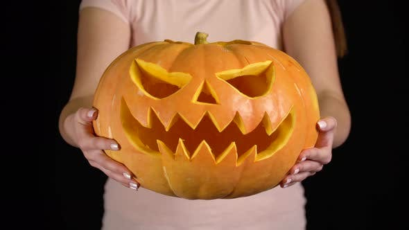Thumbnail for Woman Showing Jack O' Lantern Pumpkin for Halloween Celebration