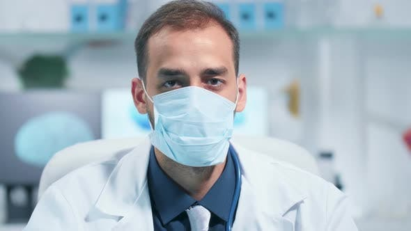 Thumbnail for Portrait of a Doctor Wearing a Medicinal Mask and Looking at the Camera
