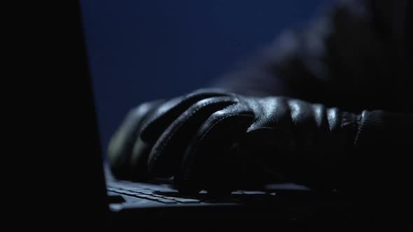 Thumbnail for Hands of Hacker in Gloves Typing on Computer, Intrusion in Corporate Network