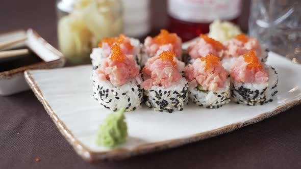 Sushi set with red caviar, beautifully presented on the table