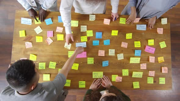 Thumbnail for Top View of Business Team Working with Sticky Notes during Meeting