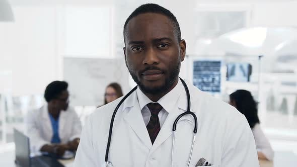 Thumbnail for Confident African Male Doctor with Team of Cowoker