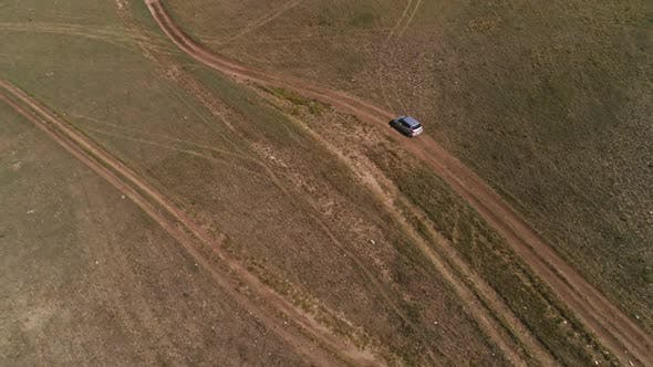 Aerial Footage Filmed with Drone of Pickup Car Riding in Steppe. the Car Travels Along the Steppe To
