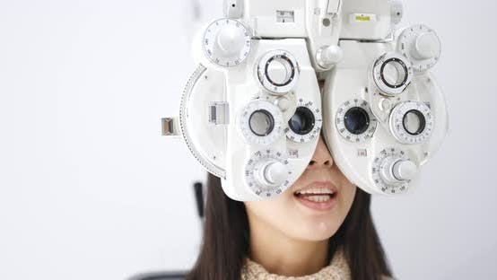Thumbnail for Woman check on eye in clinic