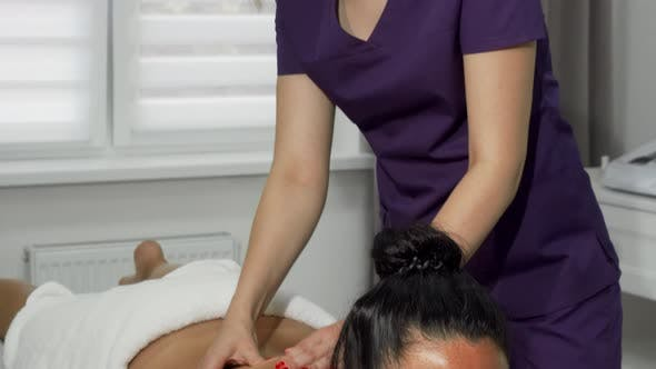 Beautiful Masseuse Smiling To the Camera While Working at Spa Center