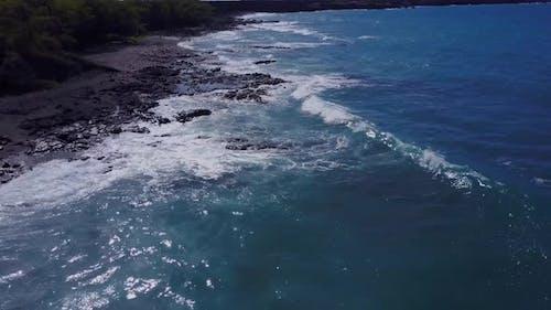 Flying Over The Rugged Coastline Of Hawaii