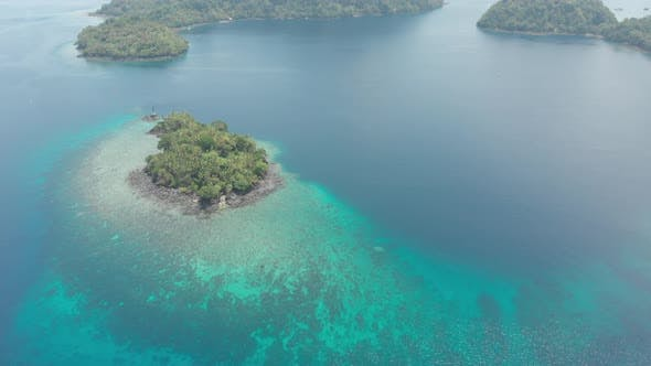 Thumbnail for Aerial: flying over tropical island Banda Islands Maluku Indonesia turquoise water coral reef
