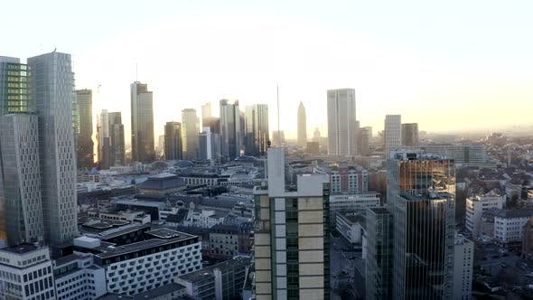 Thumbnail for AERIAL: Confident Young Man, Guy Standing on Rooftop in Skyline of Frankfurt Am Main, Germany with