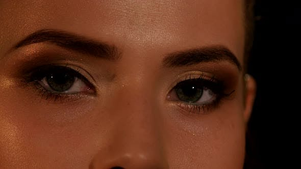 Thumbnail for Beauty Eye with Makeup Blinking. Black. Closeup