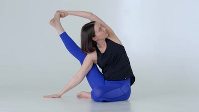 Young Woman in Sportswear Practicing Yoga