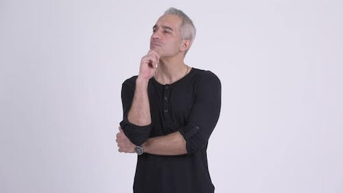 Happy Persian Man Thinking Against White Background