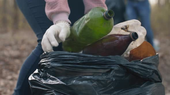 Thumbnail for Woman Putting Household Waste Into Bin Bag
