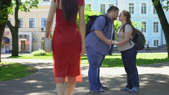 Thumbnail for Fat Man Looking at Beautiful Lady in Red Passing By, Obese Girlfriend Jealous