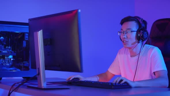 Young Asian Cyber Sportsman Playing