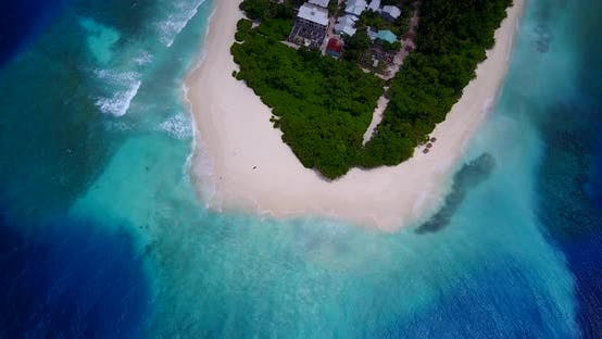 Thumbnail for Tropical flying travel shot of a white paradise beach and aqua blue water background
