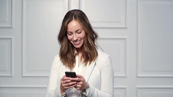 Thumbnail for Businesswoman Texting on Phone