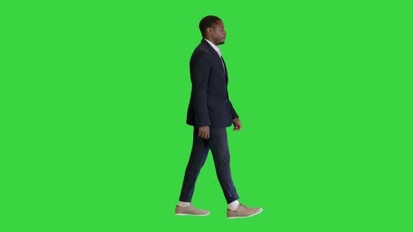 African Businessman in Formal Wear Walking on a Green Screen, Chroma Key.