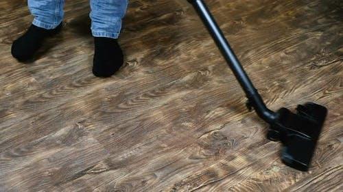 Man Vacuuming Vacuum Cleaner Laminate
