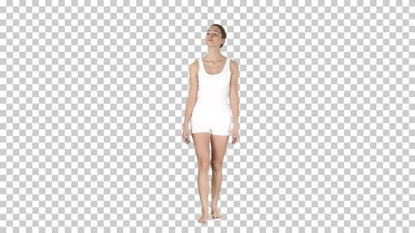 Thumbnail for Young woman in white walking on her toes barefoot, Alpha Channel