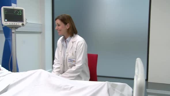 Thumbnail for Female doctor sitting and talking with female patient